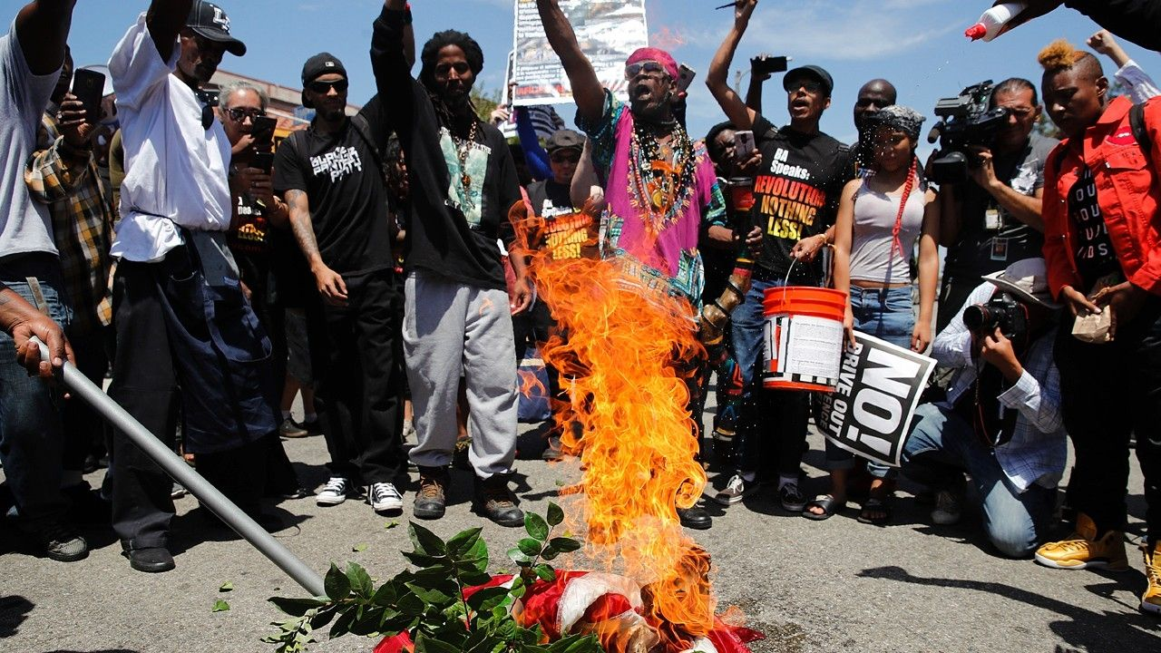 Maxine Waters reacts to flag burning demonstration outside her office this week